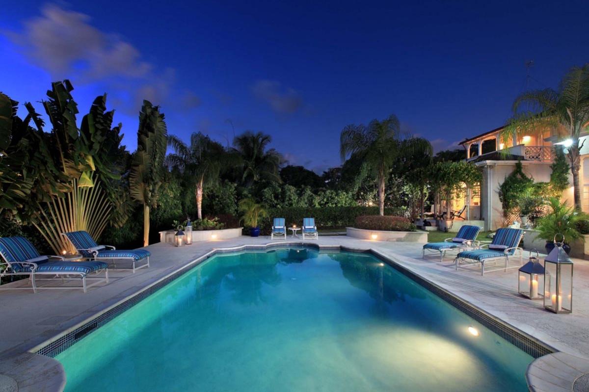 Sandy lane 4's beautiful pool lit up under the night sky