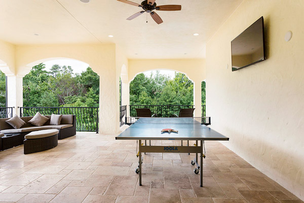 You can play ping pong at this luxury vacation rental