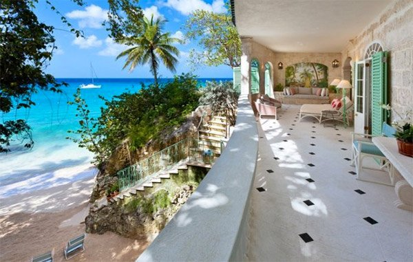 This villa is right on the beachfront in Barbados