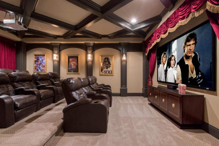 Movie theater with projector screen and cinema-style seating