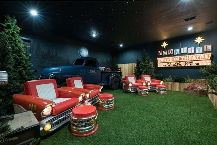 This villa features a drive-in style movie room with themed car seating