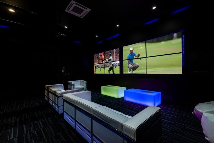 The villa features a game room with a video screen wall