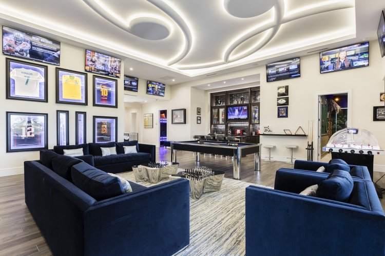 This villa features a sports themed game room