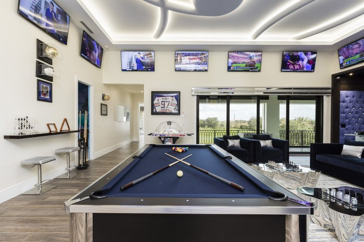 This sports themed game room features a pool table