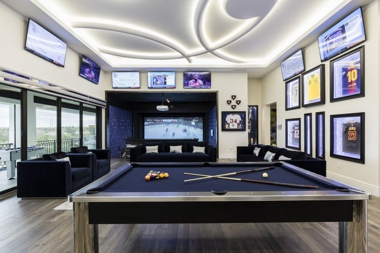 A modern game room with multiple televisions