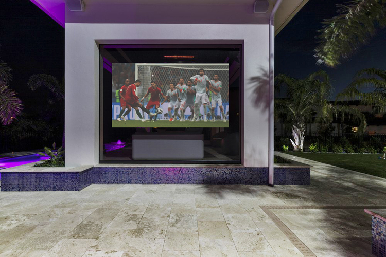 This villa features a large projector screen outside