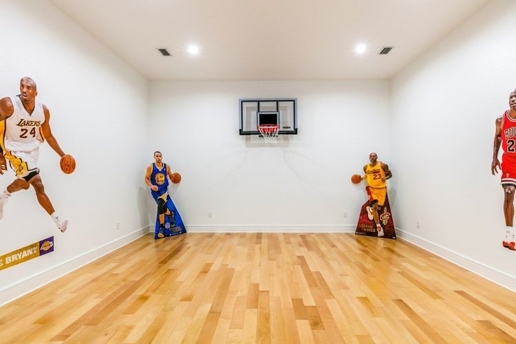 Indoor basketball court with cardboard cutouts of professional players