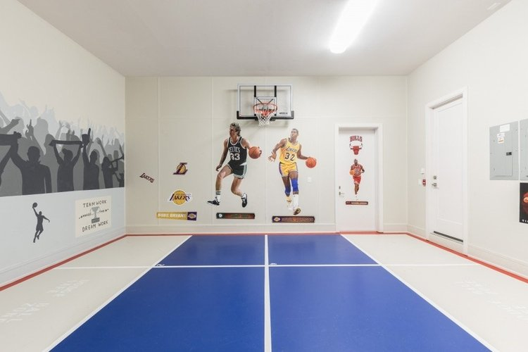 This villa features an indoor basketball court