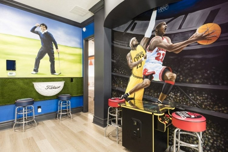 Game room with basketball and golf murals painted on the wall