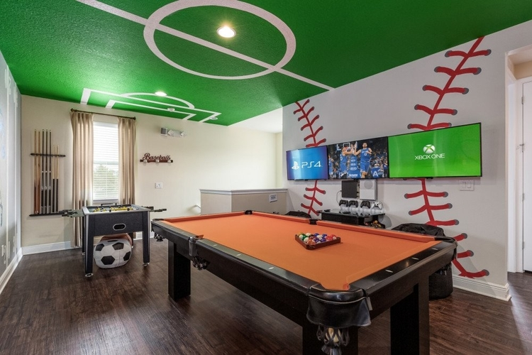 Sport themed game room with pool table and foosball table