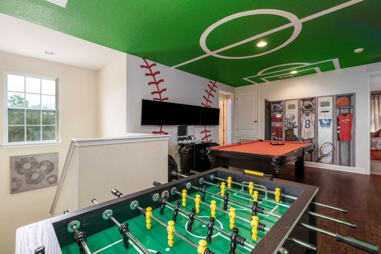 Game room with foosball table, pool table and locker room style artwork