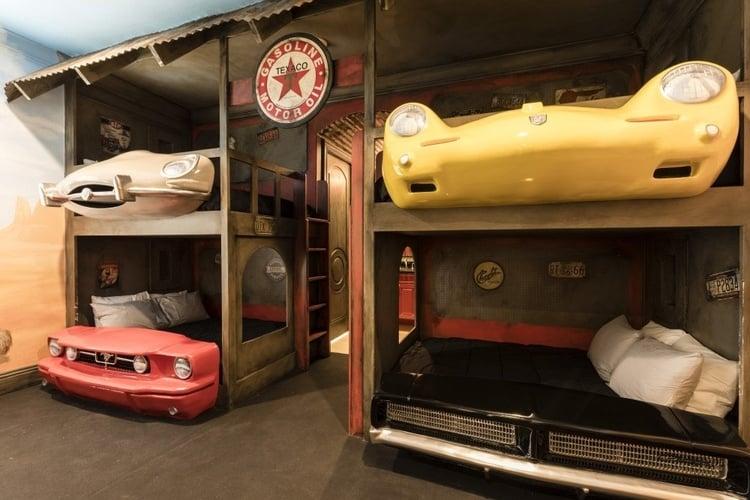 Car themed bedroom with custom-built car bunkbeds