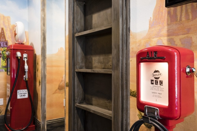 Car themed kids bedroom with petrol pumps and custom-built bunk beds