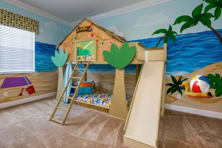 Beach themed bedroom with custom-built tiki hut bunkbed with slide