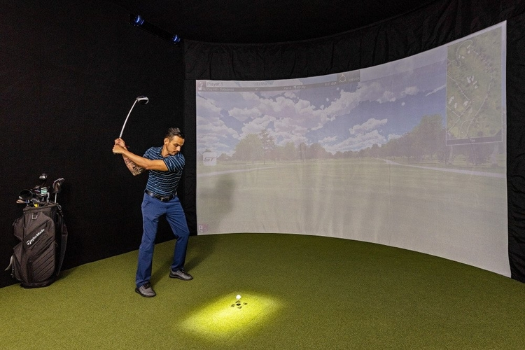 This home features an HD golf simulator with 87 courses to choose from