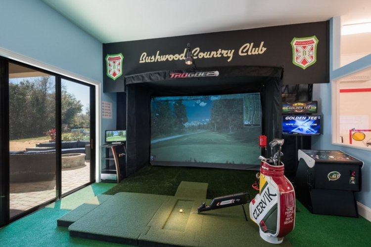 Indoor golf simulator with clubs, balls and a variety of courses to choose from