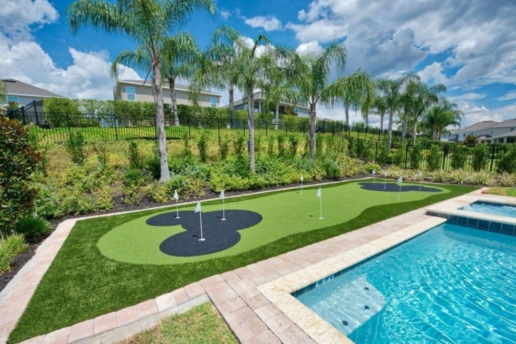 This luxury home features a private 9-hole putting green in the garden