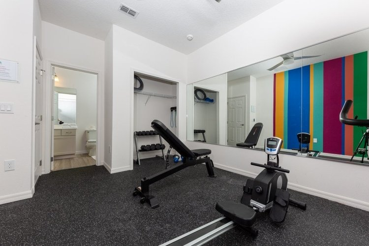 This gym features weights, a rowing machine and an en-suite bathroom