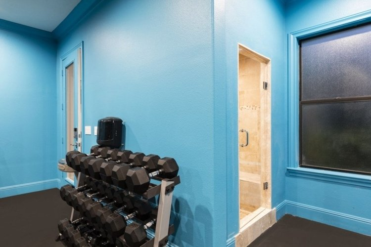 This private gym overlooks the swimming pool
