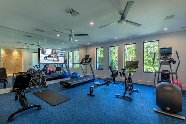 A large indoor gym with a great range of modern equipment