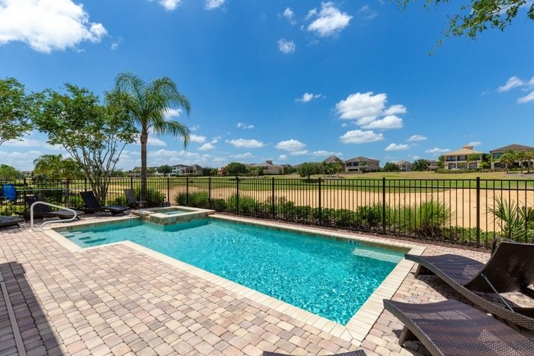 Outside you will find a private pool with golf course views