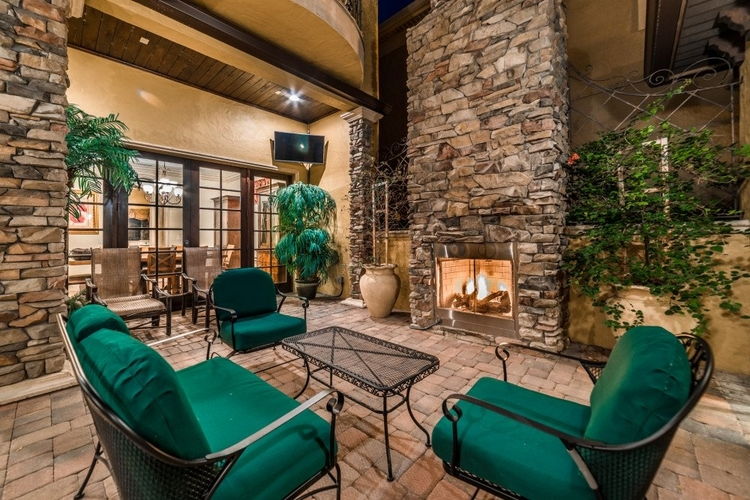 A private brick courtyard features a fireplace and relaxing lounge seating