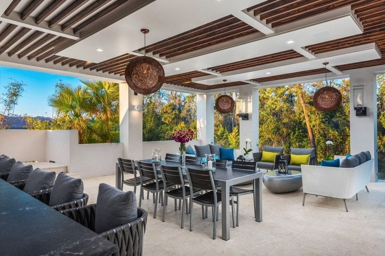 The covered lanai features an alfresco dining area and relaxing lounge seating
