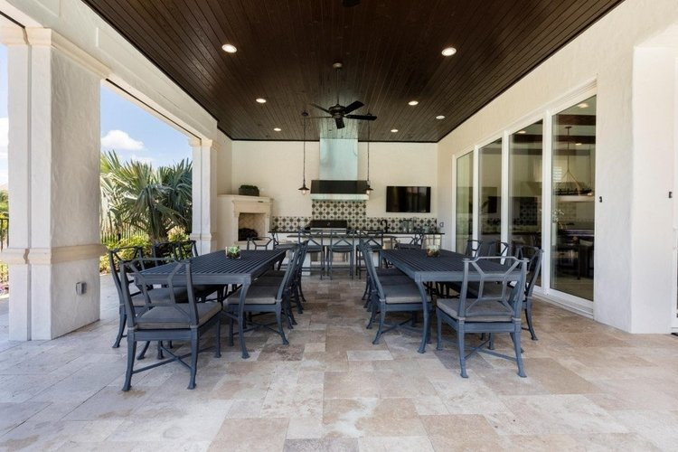 The covered lanai features an alfresco dining area and an outdoor kitchen