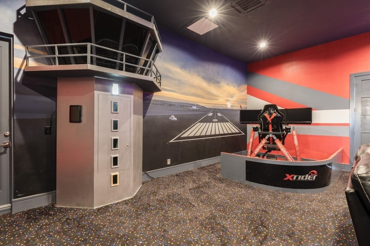 In the themed game room there is a flight simulator
