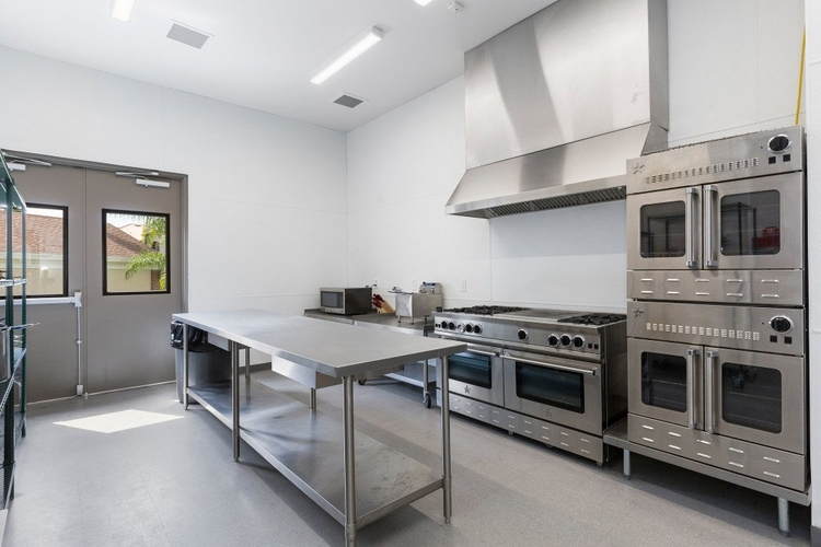 The villa features a professional commercial kitchen, which has a service entrance