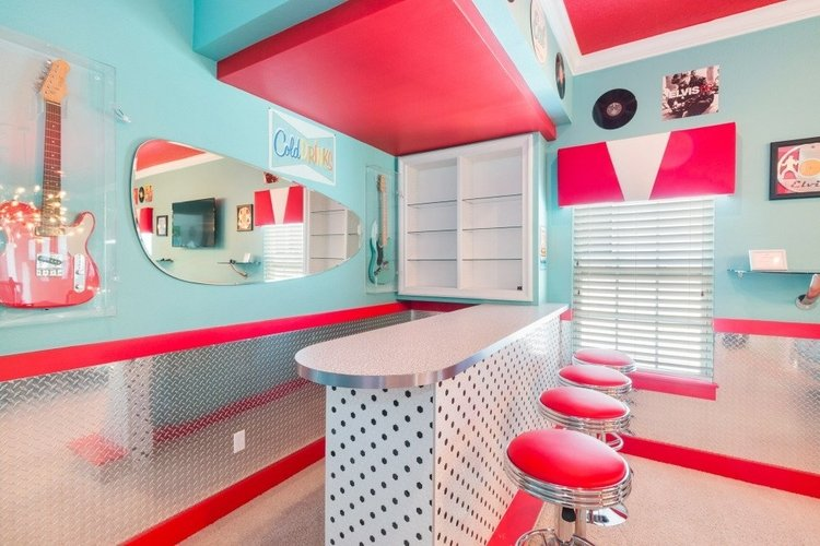 Designed to look like a 1950's diner, there is a retro bar area with bar stool seating