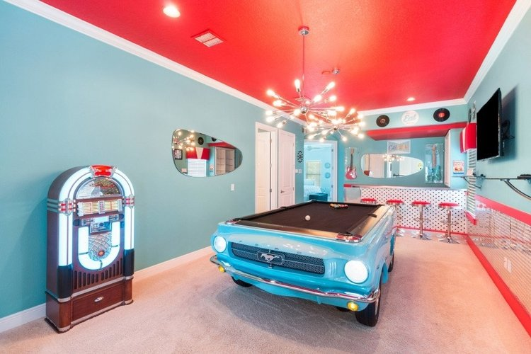 This villa features a themed living space upstairs, with a pool table and jukebox