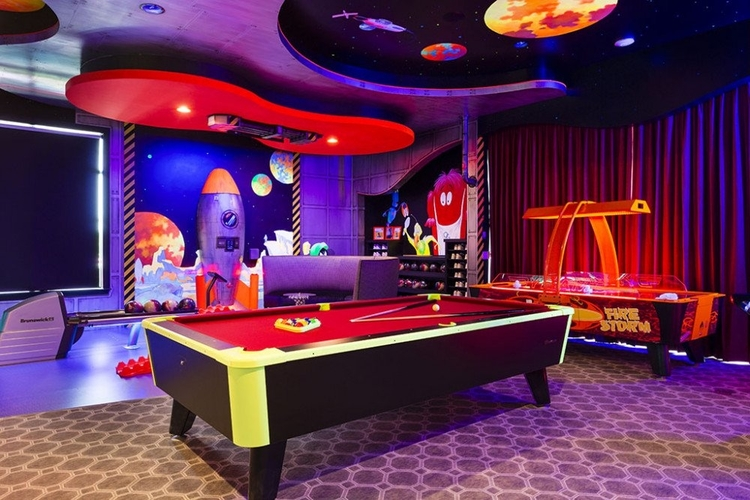 Located in Reunion Resort 10000, this glow-in-the-dark game room has a range of amenities