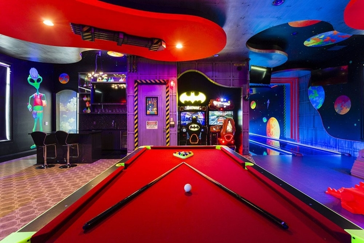 The game room features a pool table, an air hockey table and a 2 lane bowling alley
