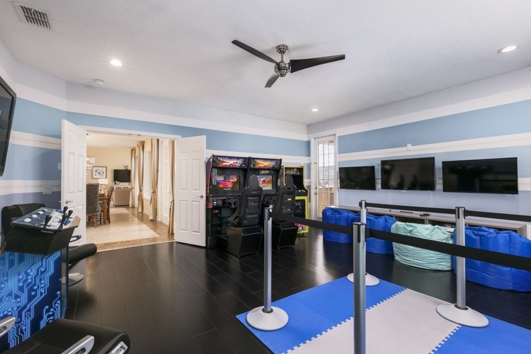 This family game room features a number of arcade video games