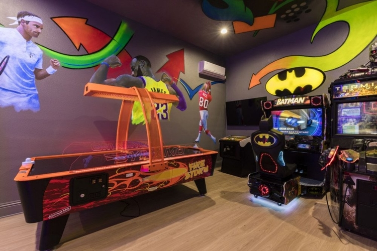 With sports themed decor, this game room has a number of video arcade games