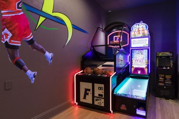 This sport themed game room features a basketball shooting game