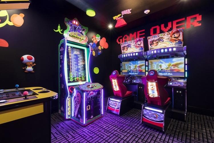 Hidden within Reunion Resort 2600, this secret arcade room has glow in the dark decor