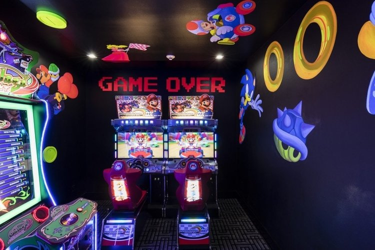 This glow in the dark room features a number of arcade games including Mario Kart