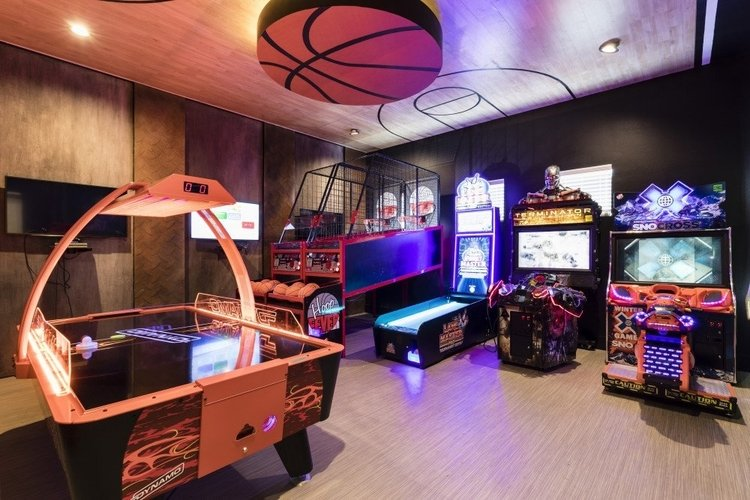 This basketball themed game room has a number of arcade video games