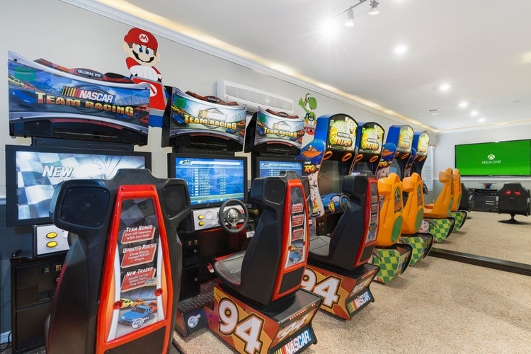 There is a number of racing arcade games in this villa, as well as a games console