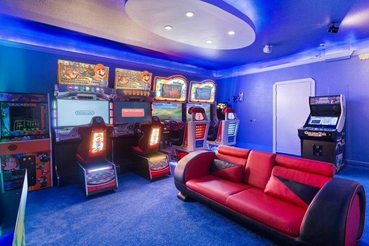 The game room in Windsor Hills 602 features a number of video arcade games