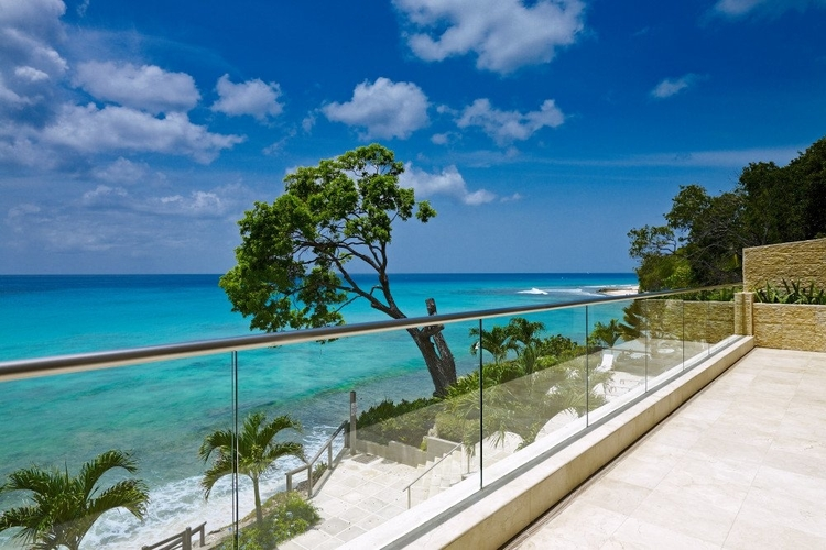 Private sun terrace with steps down to the beach