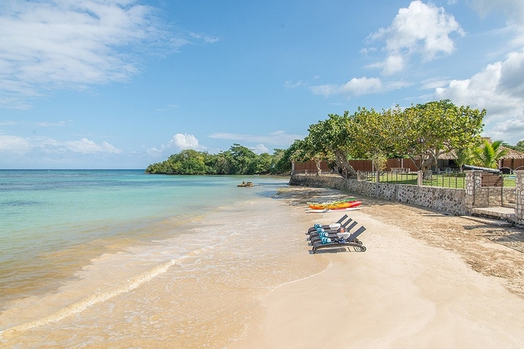 The villa has a private beach with sun loungers and kayaks