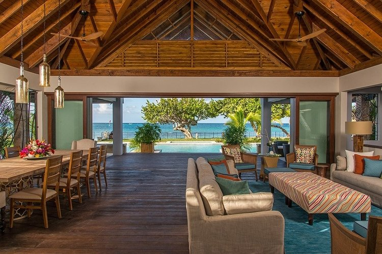 Open-plan living and dining area overlooks the Caribbean Sea
