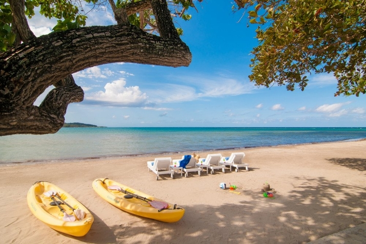 Private white sand beach with complimentary kayaks and sunloungers
