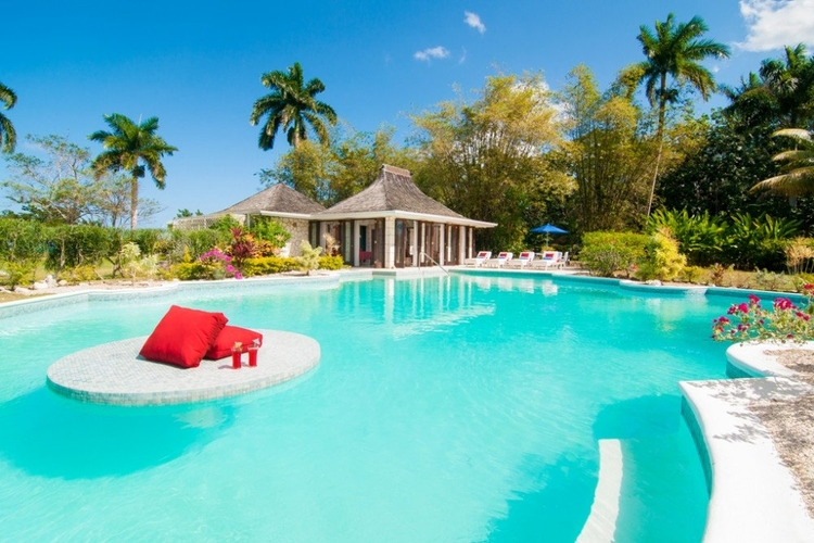 Bright blue swimming pool with poolside gazebo and bar