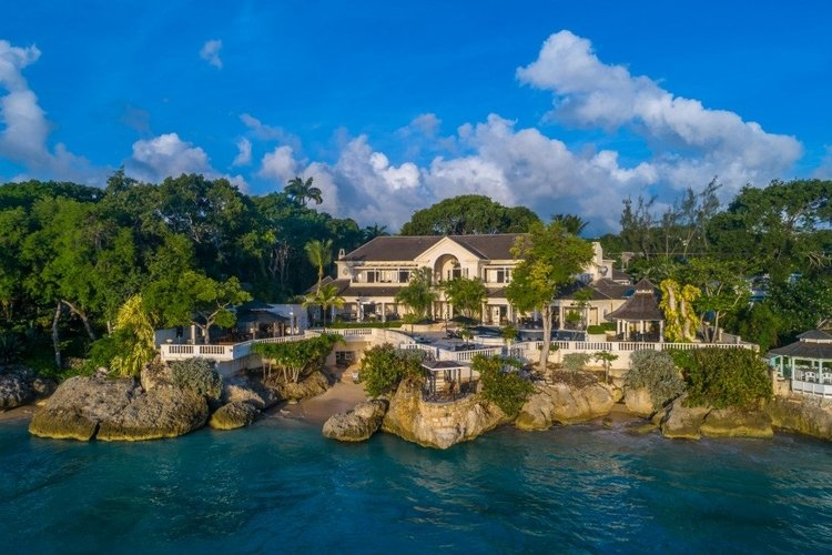 Waterfront villa with private pool and access to a private beach