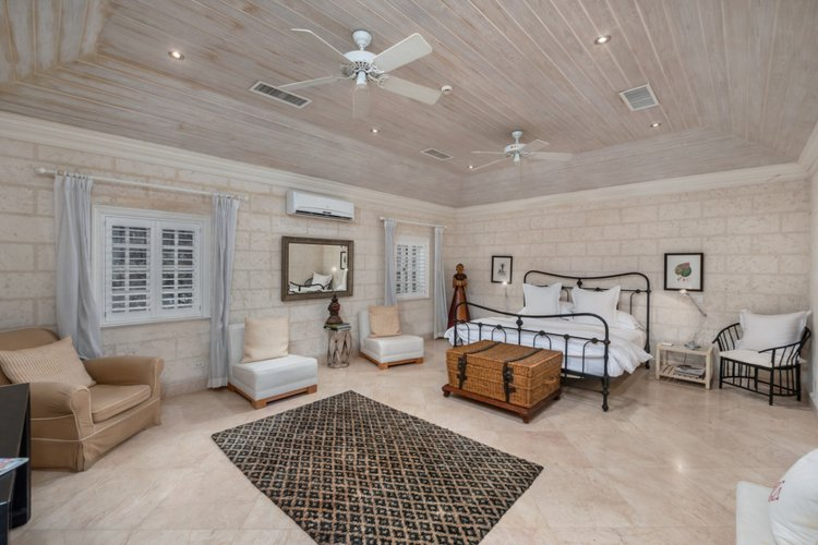 King-size bedroom with marble floors and air conditioning