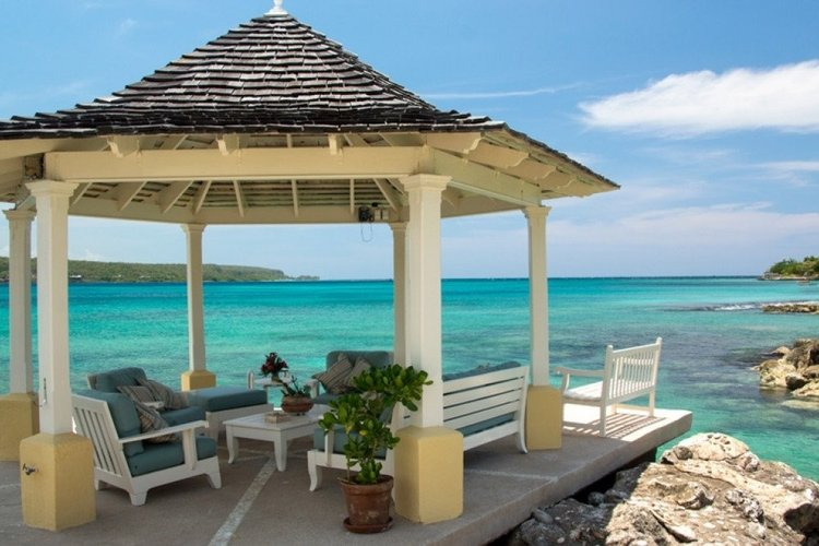 Waterfront gazebo with lounge seating overlooking the Caribbean Sea